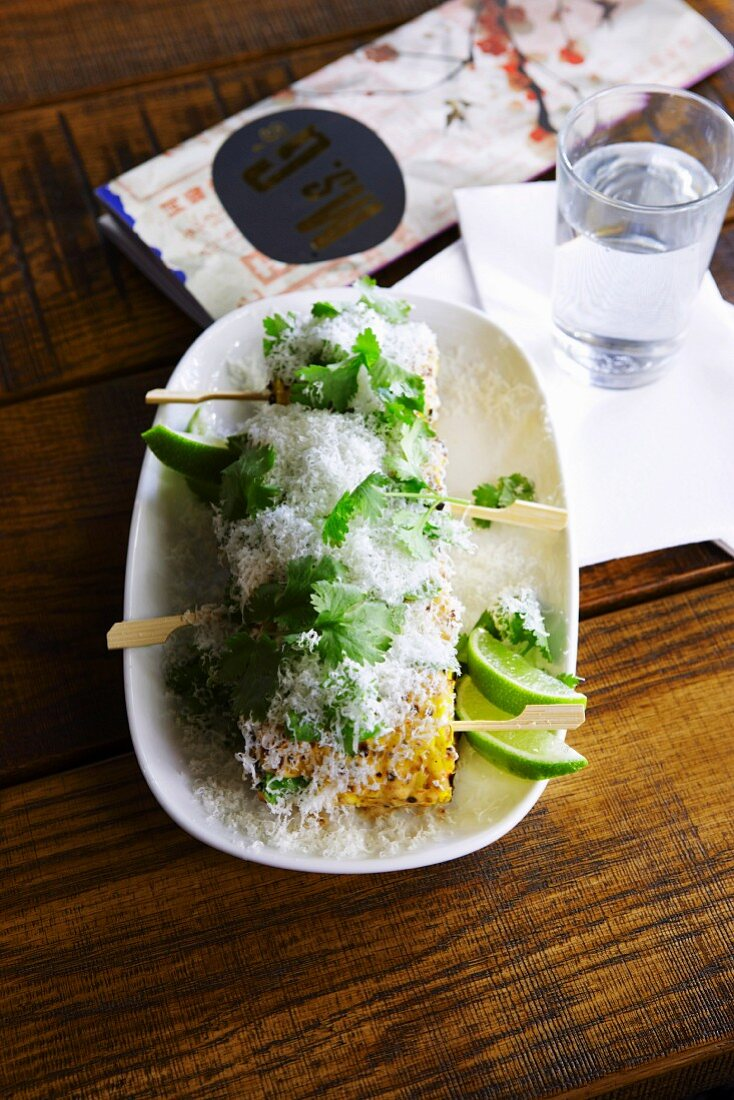 Barbecued corn on the cob with parmesan and lime