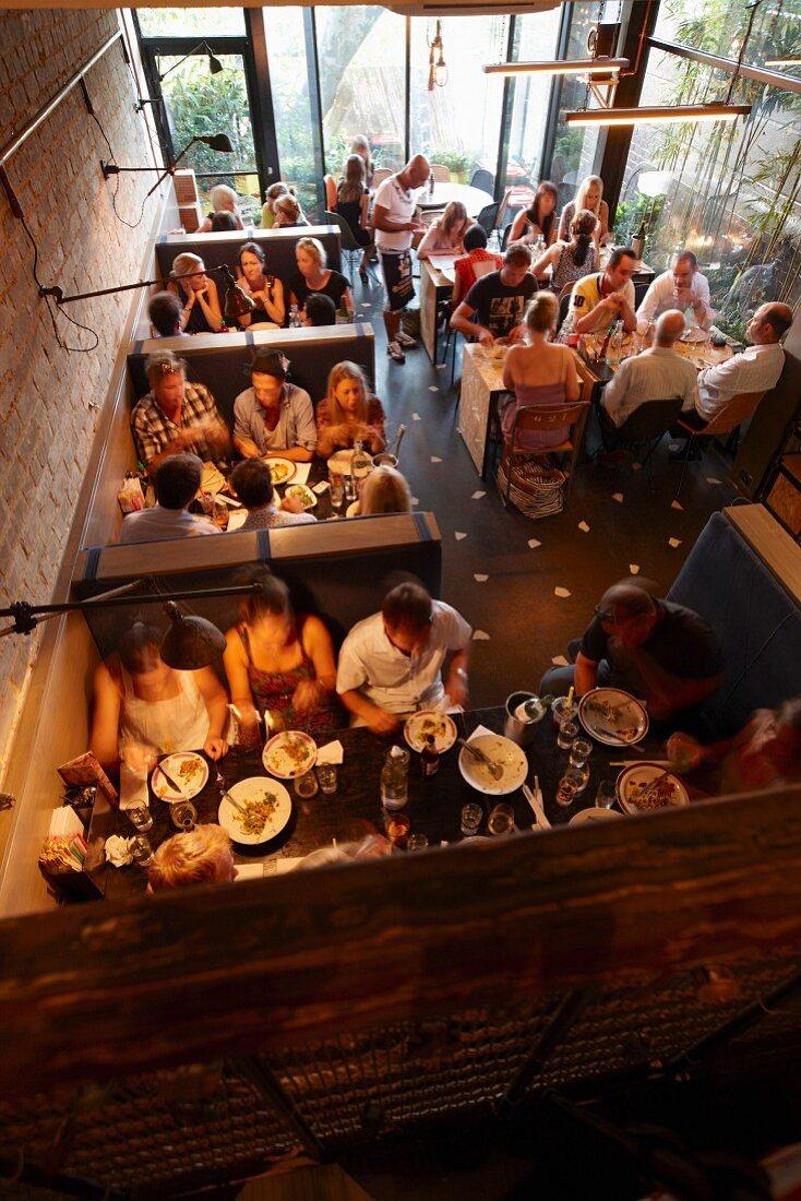 Lots of people in a modern Asian restaurant (Sydney, Australia)
