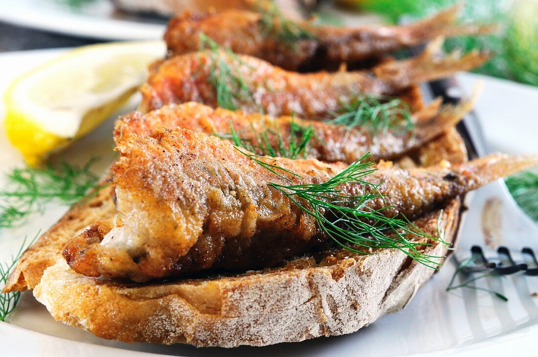 Toast topped with fried red mullet
