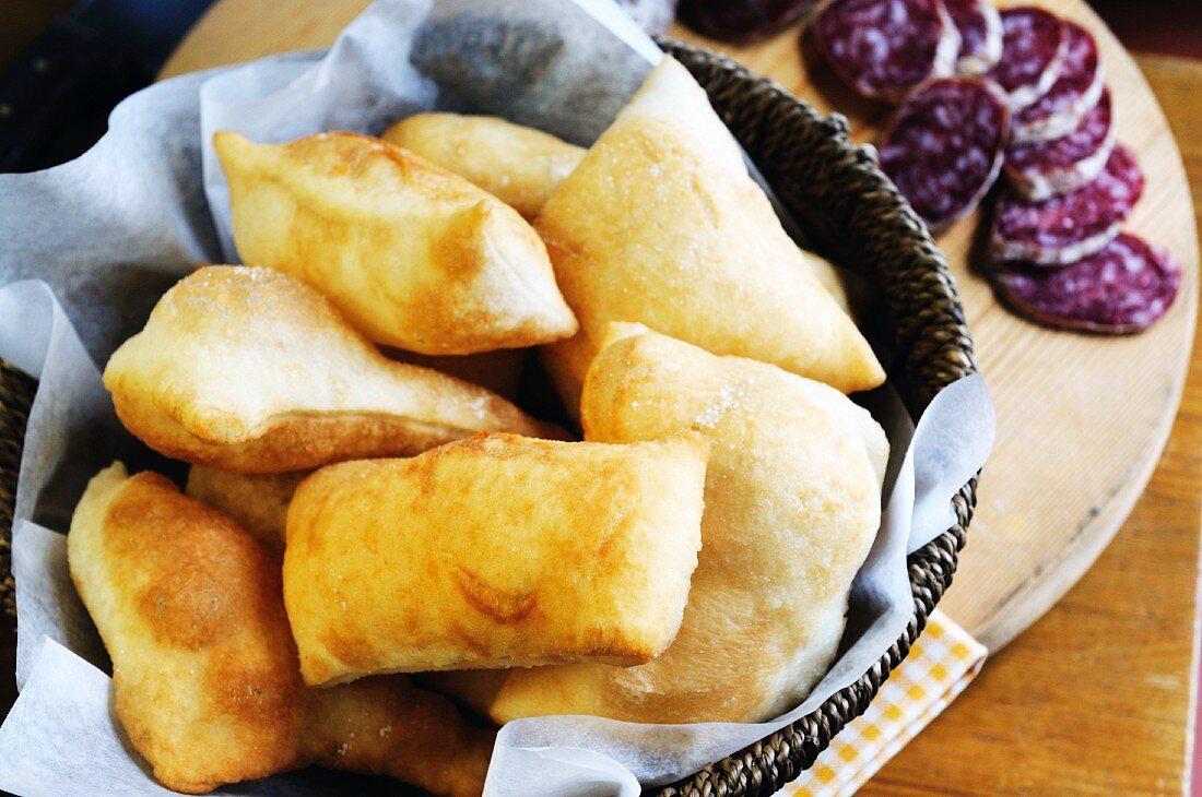 Torta fritta con salame (fried Italian pastries)