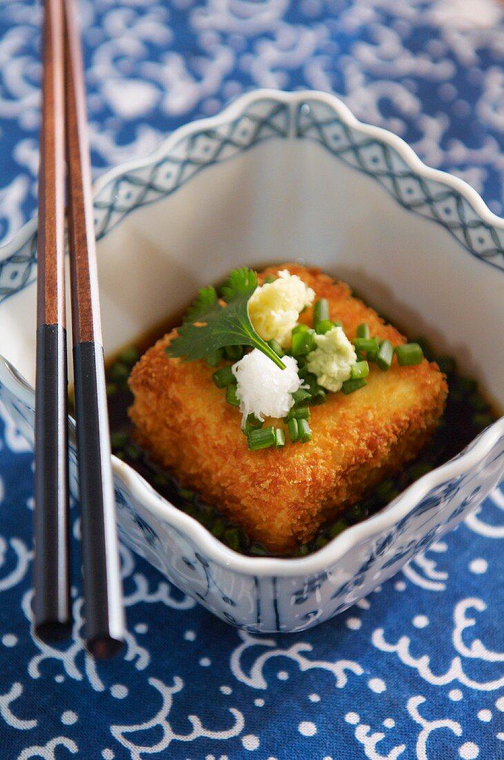 Baked tofu with was wasabi, daikon and herbs