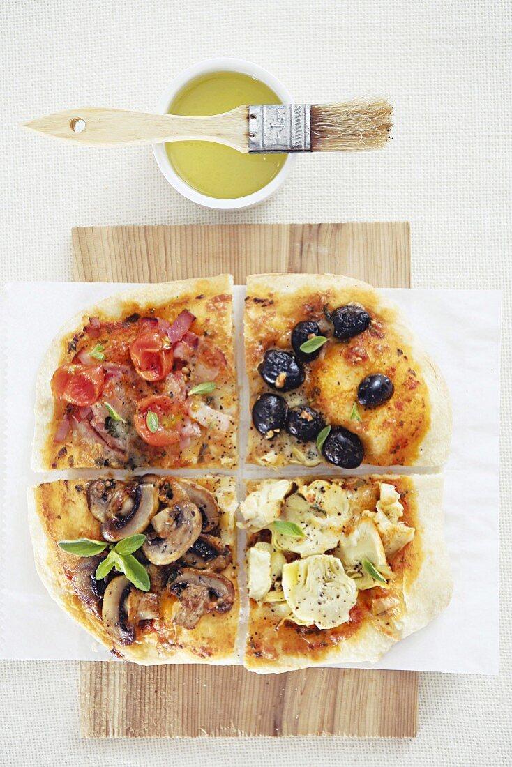 A Quattro Stagioni pizza with ham, mushrooms, olives and artichokes