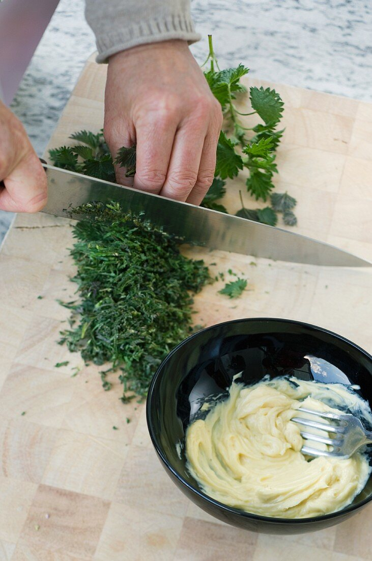 Stinging nettle butter being made
