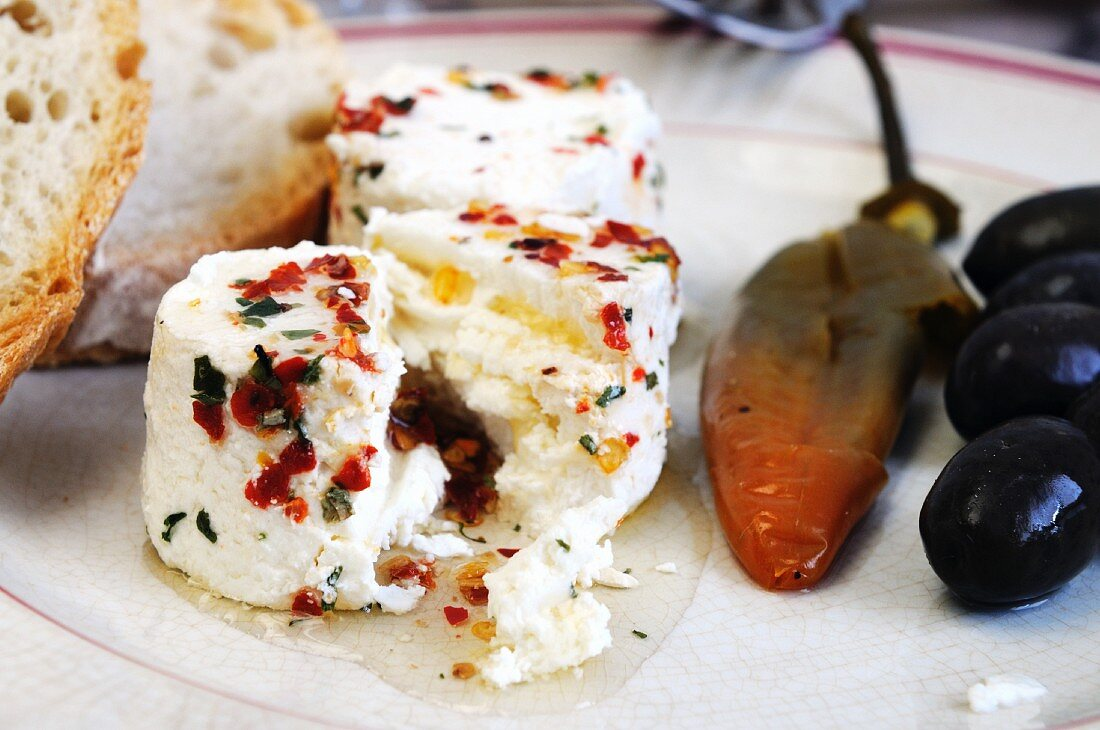 Marinated cheese (Agri die Valtorta) with chilli and olive oil (Italy)