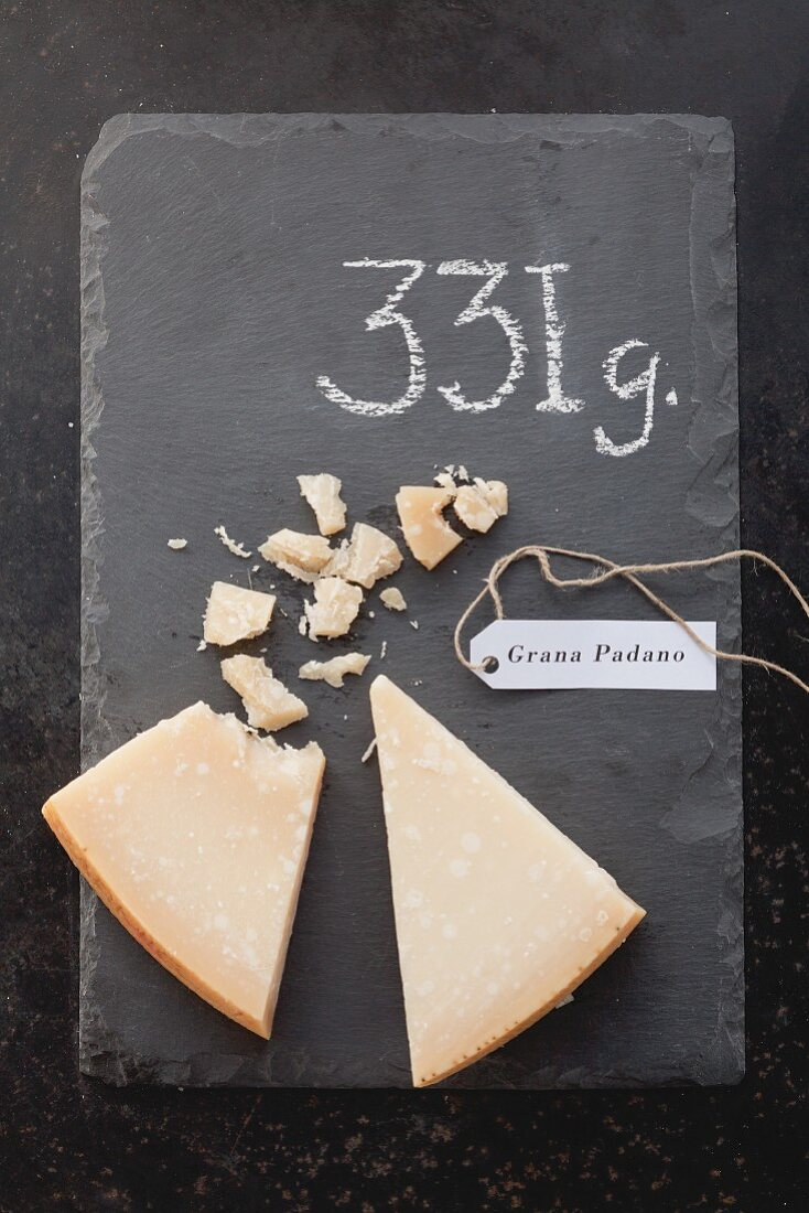 Grana Padano with a label and its weight
