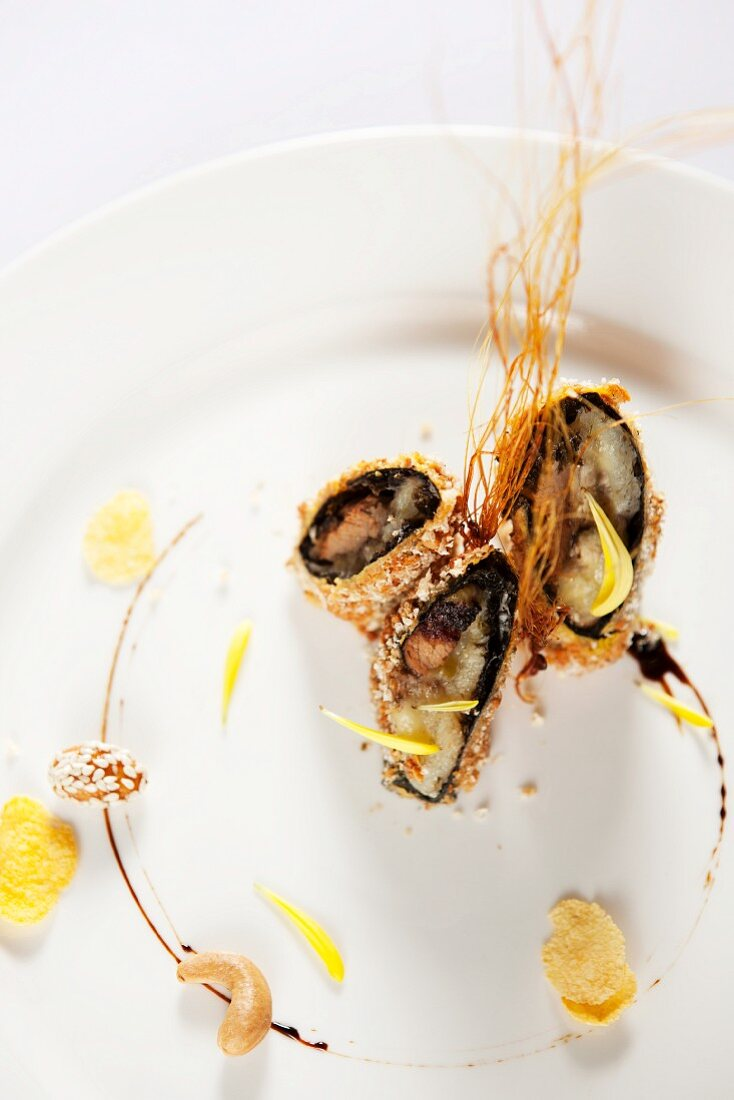 Crispy beef roll with banana and caramel strands (China)