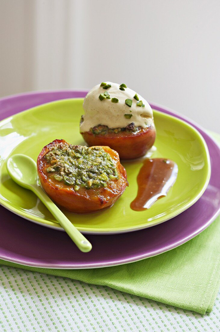 Roasted nectarines with pistachios and cream