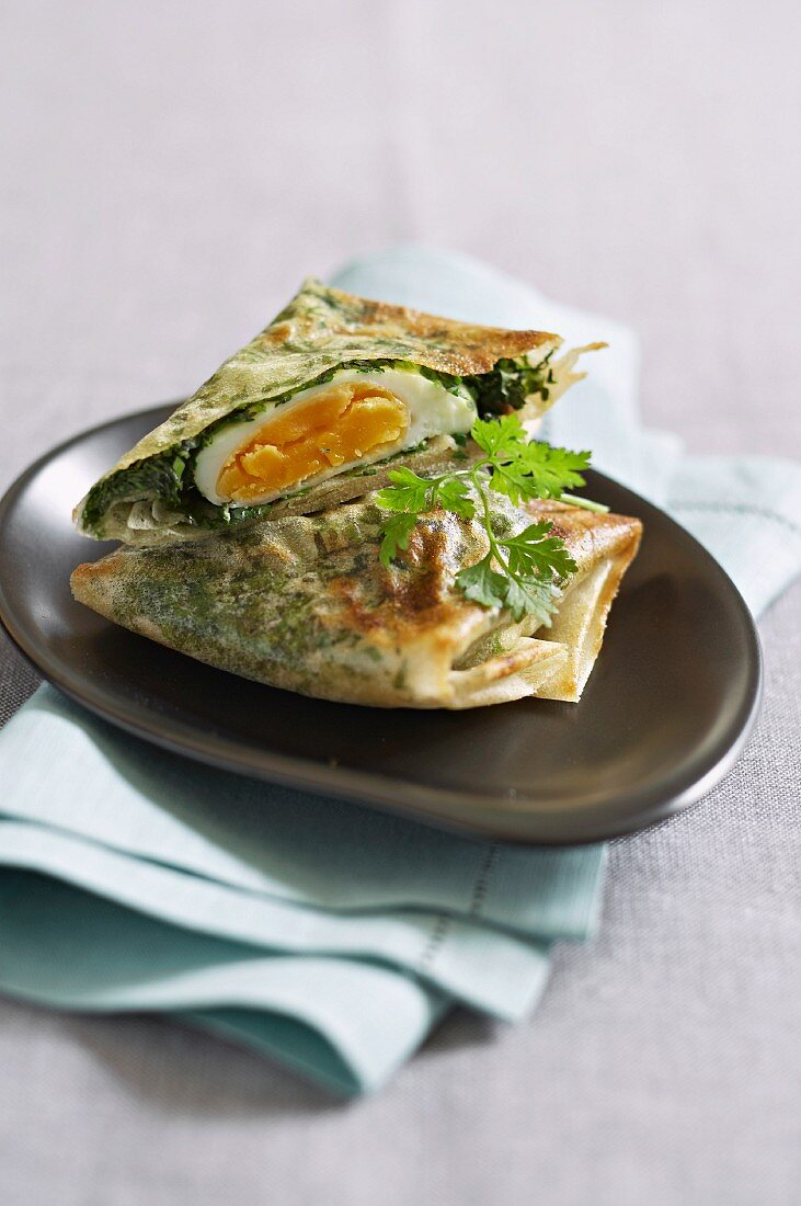 Brick dough pastries filled with egg and herbs