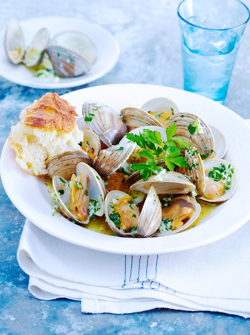 Steamed Clams with Garlic and Parsley; Piece of Crusty Bread
