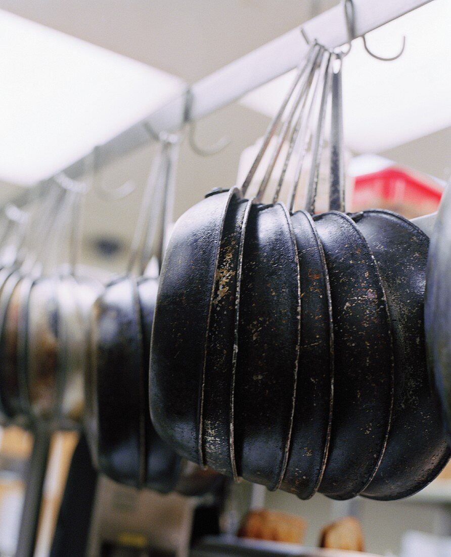 Sautee Pans Hanging in a Kitchen