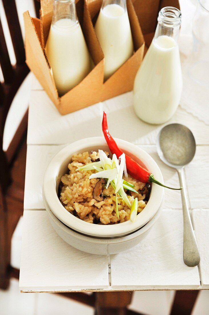 Rice congee with mushrooms and spring onions (Asia)