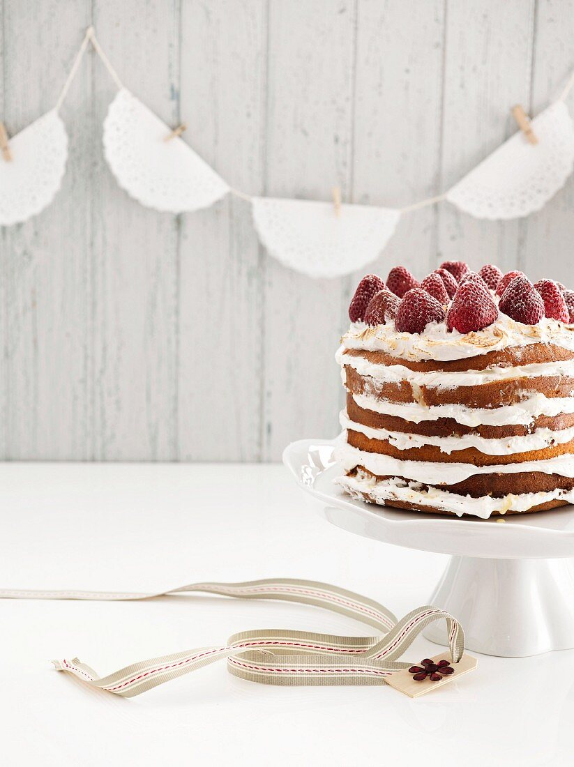 Tres Leches cake with meringue and strawberries