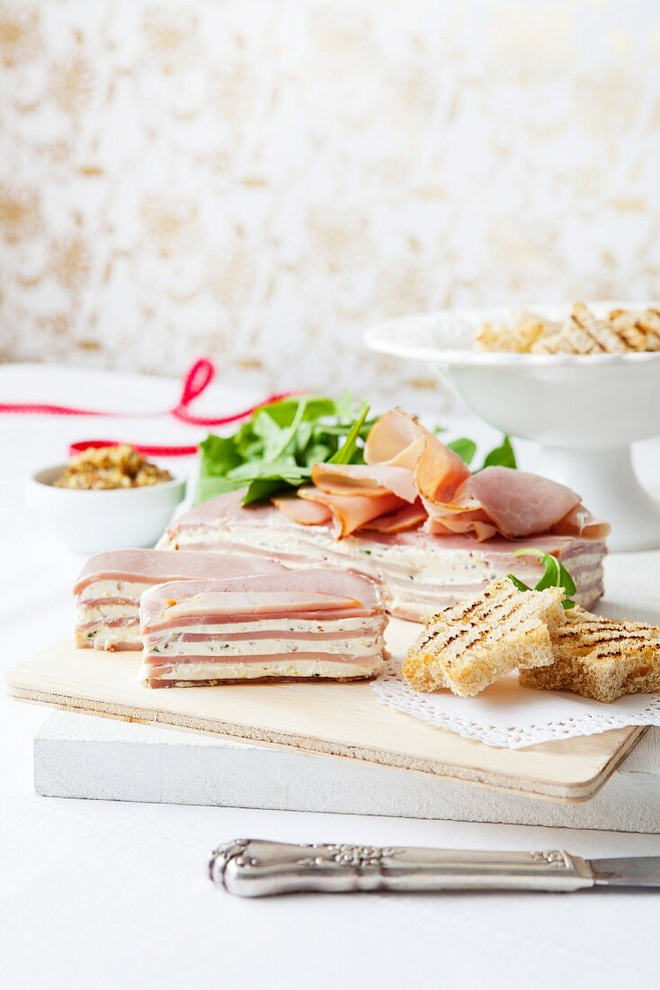 Ham and cream cheese terrine with chives and mustard for Christmas