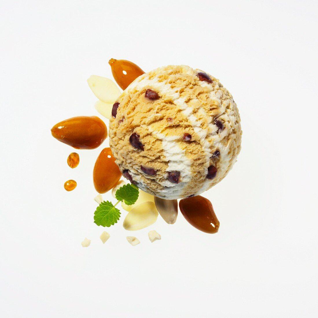 Almond ice cream with caramelised almonds, flaked almonds, chopped almonds, caramel drops and lemon balm