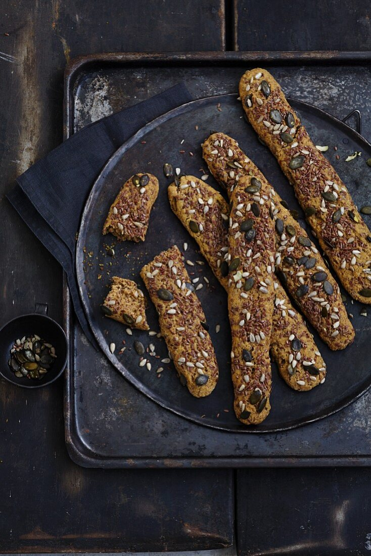 Gluten-free wholemeal bread sticks topped with seeds