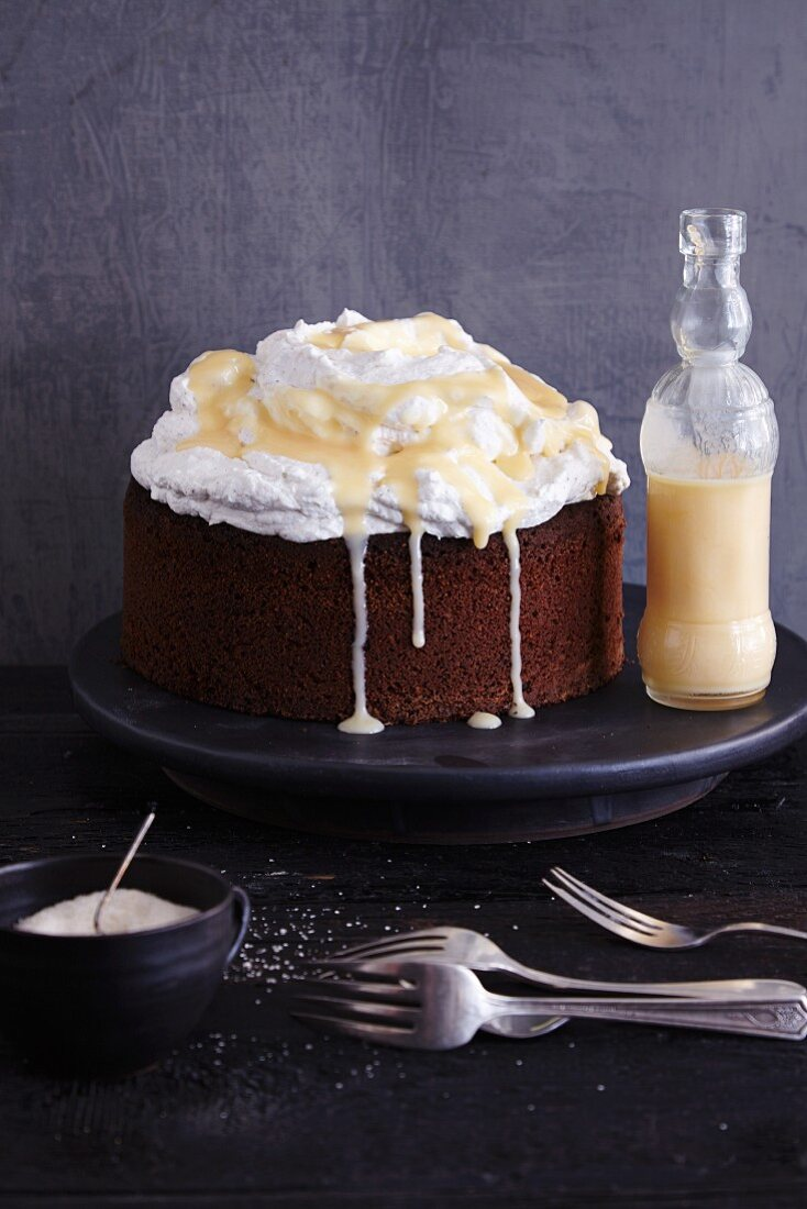 Gluten-free walnut cake topped with cream and eggnog
