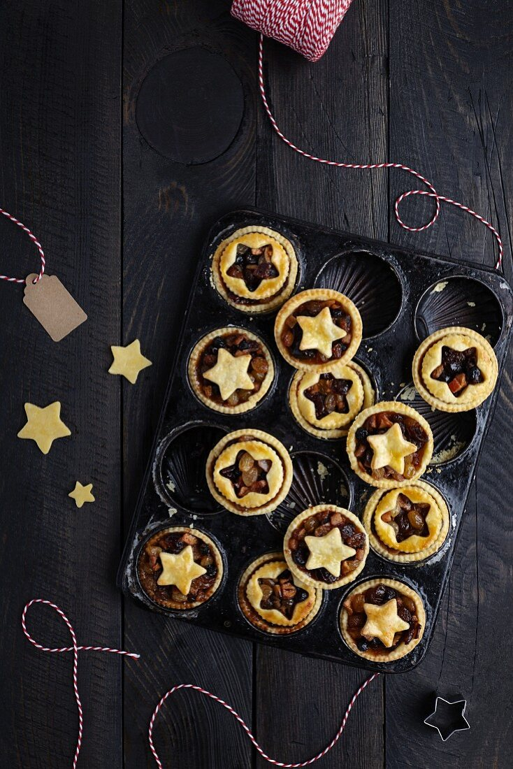 Freshly baked mince pies in an old baking tin