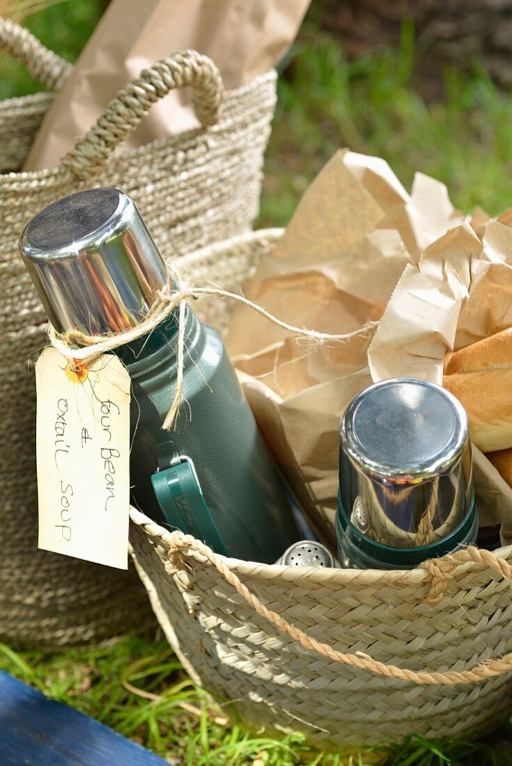 A picnic basket with oxtail soup in Thermos flasks