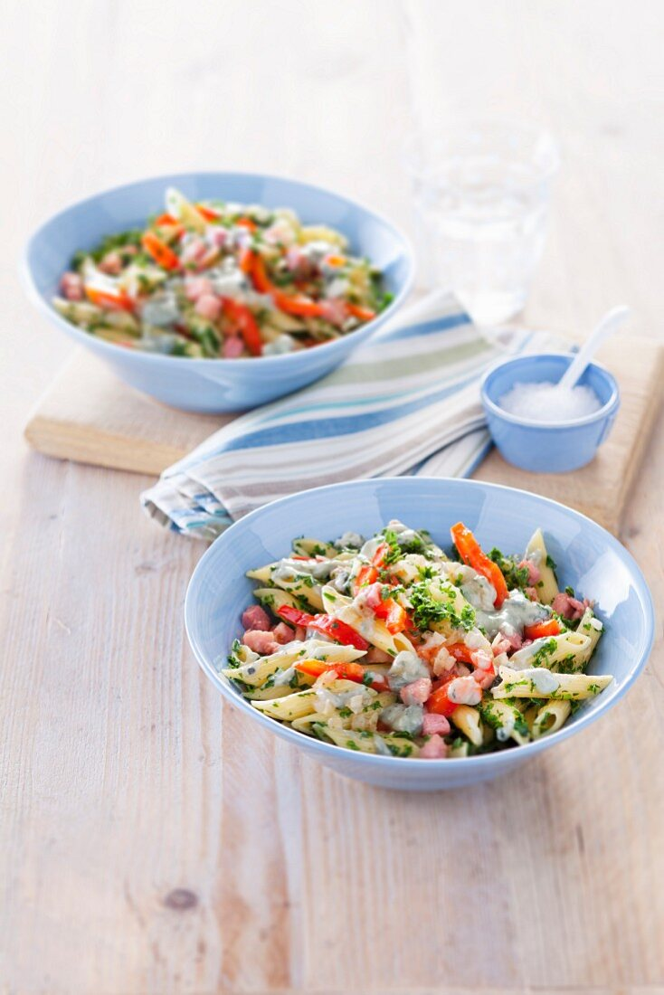 Penne pasta with kale, bacon, pepper and gorgonzola sauce