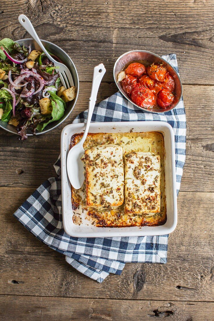 Gratinated sheep's cheese with cherry tomatoes and bread salad