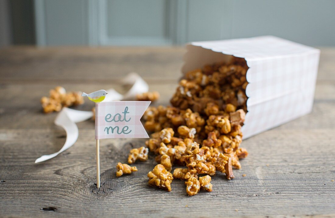 Homemade caramel popcorn with dried apple pieces