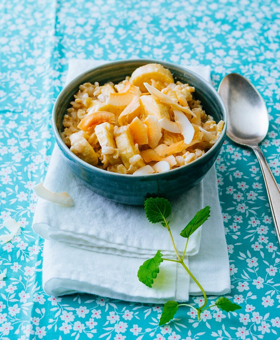 Porridge made from natural rice, bananas and coconut chips