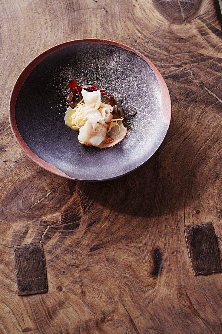 Cod cheeks with celeriac, char caviar and Gallardo at the restaurant Oaxen Krogrun by chef Magnus Ek, Stockholm