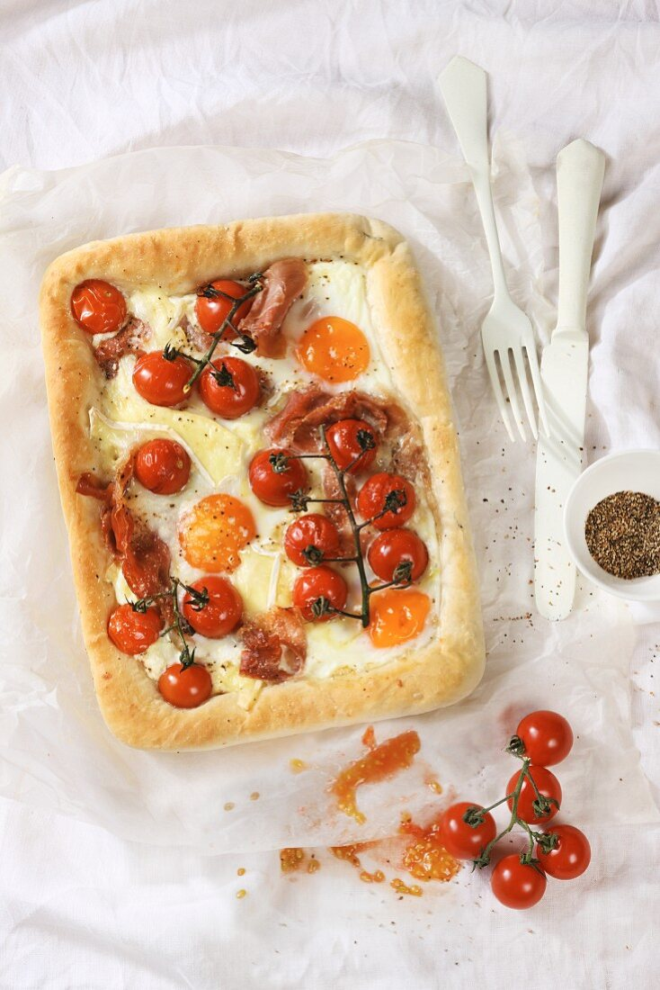 Camembert cake with eggs and tomatoes