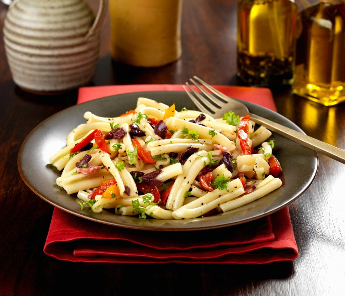 Gluten-free pasta with peppers, olives, herbs and olive oil