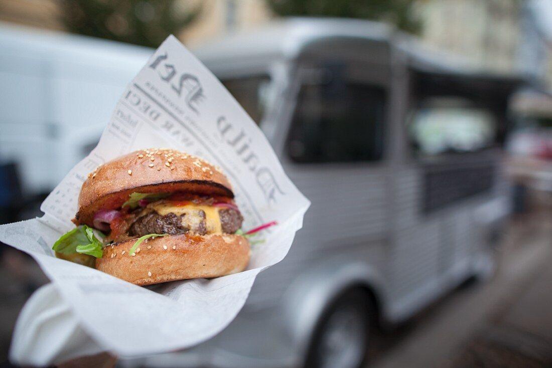 A hamburger from a fast food truck
