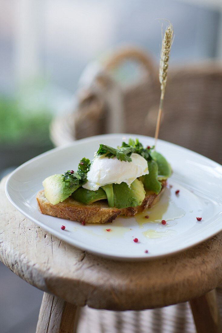 Country bread topped with avocado and poached egg at TTCCH (Till the cows come home), Berlin