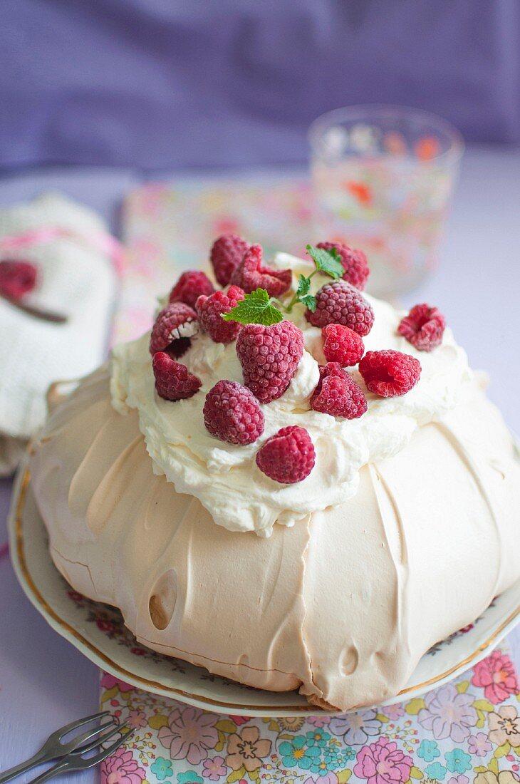 Pavlova (meringue cake) with mascarpone cream and fresh raspberries