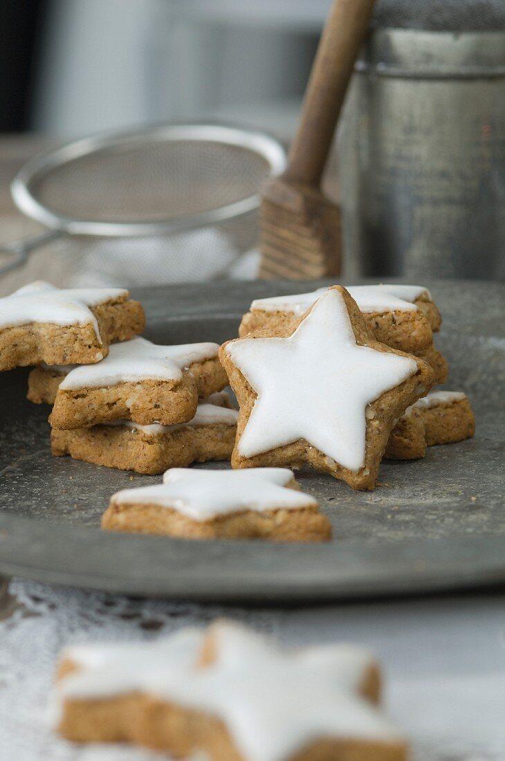 Cinnamon stars on a rustic pewter plate