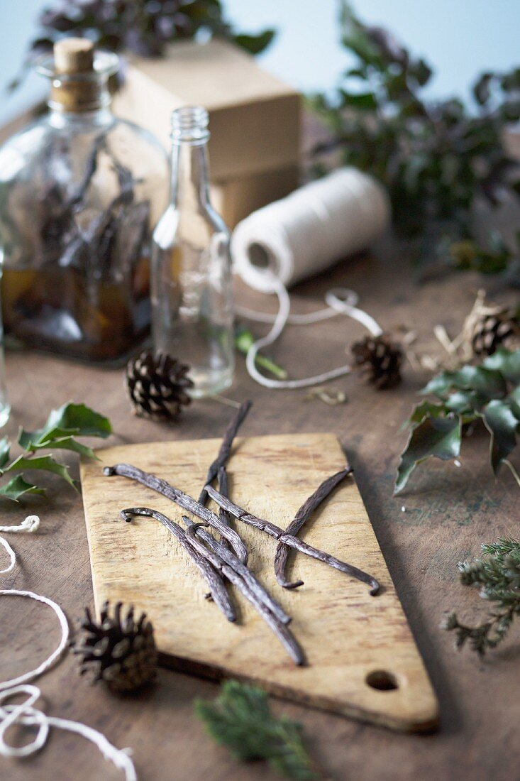Vanilla extract being made: a vanilla pod on a wooden chopping board