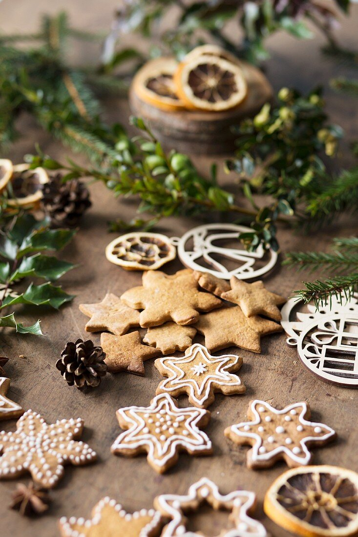 Star shaped biscuits with gingerbread spice, some decorated with icing