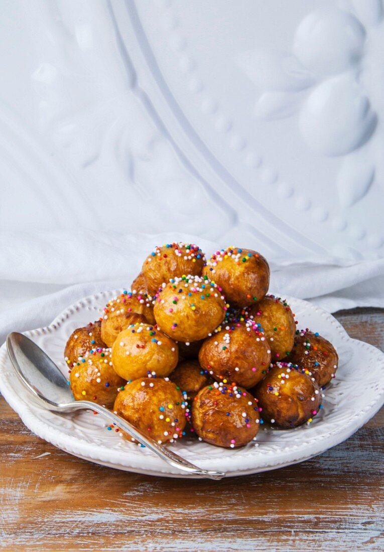 Struffoli (Italian honey balls) with coloured sugar sprinkles