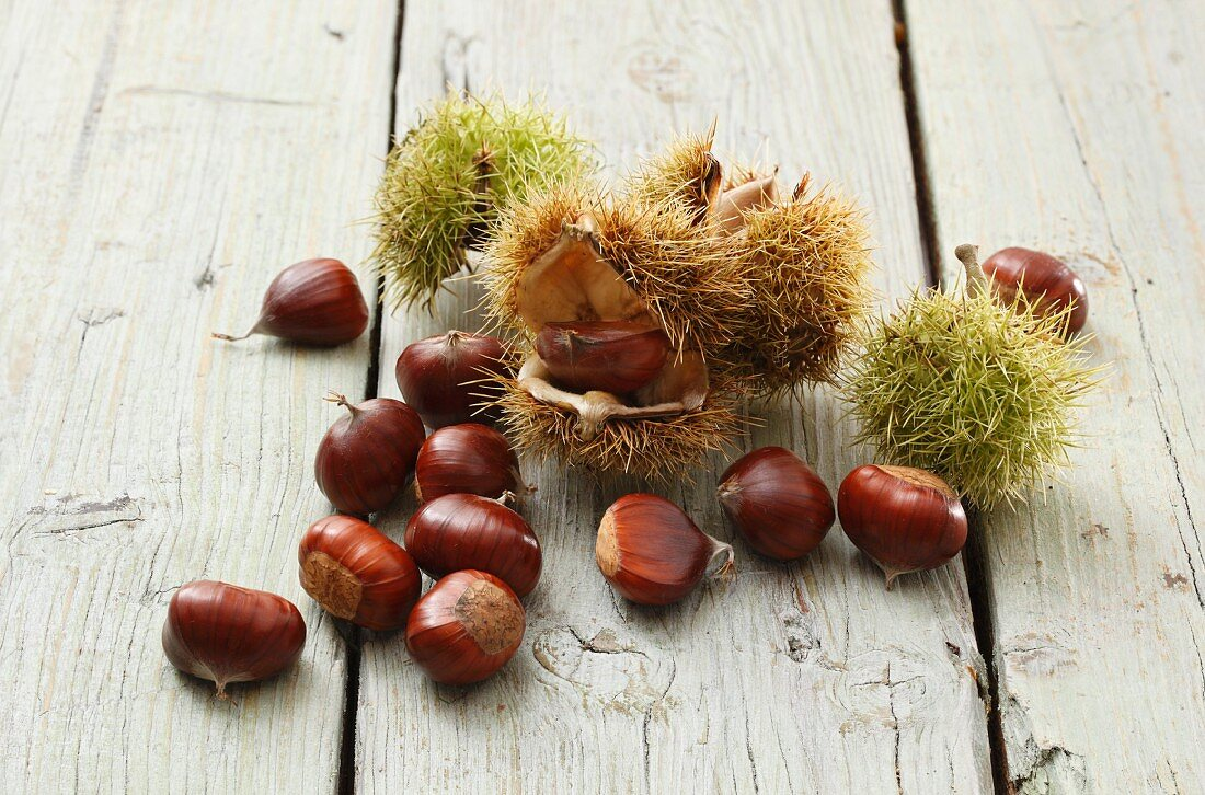 Chestnuts and cases on a wooden surface