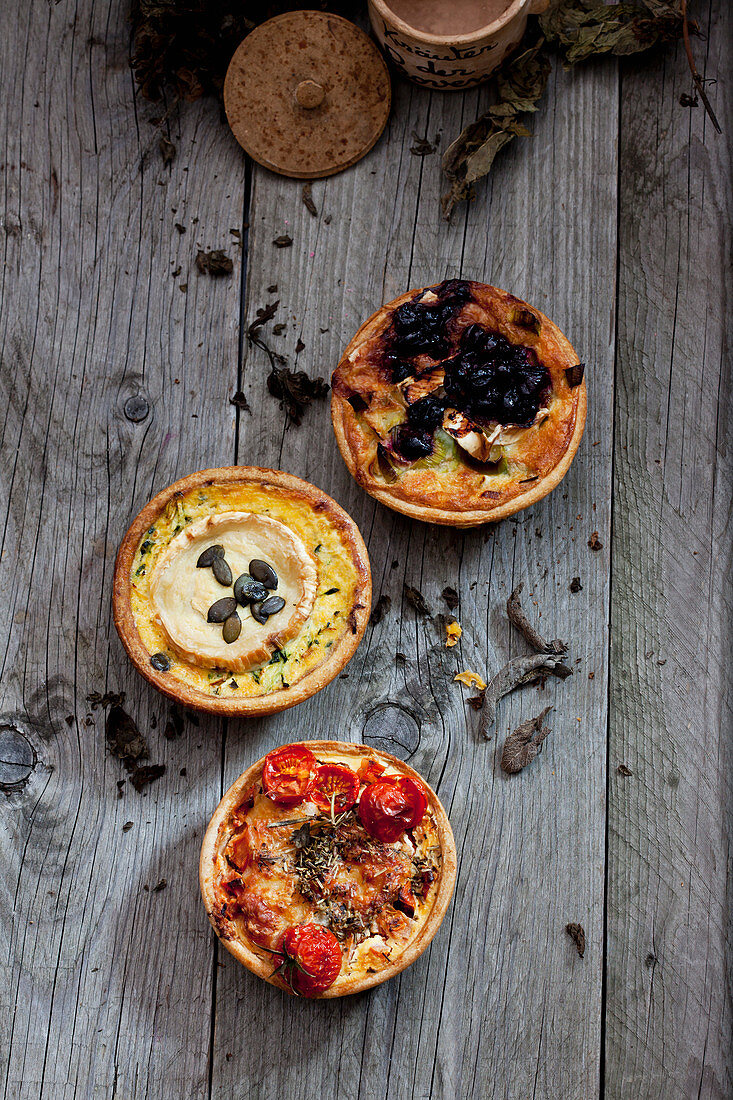 Three mini quiches with cranberries, goats cheese and tomatoes