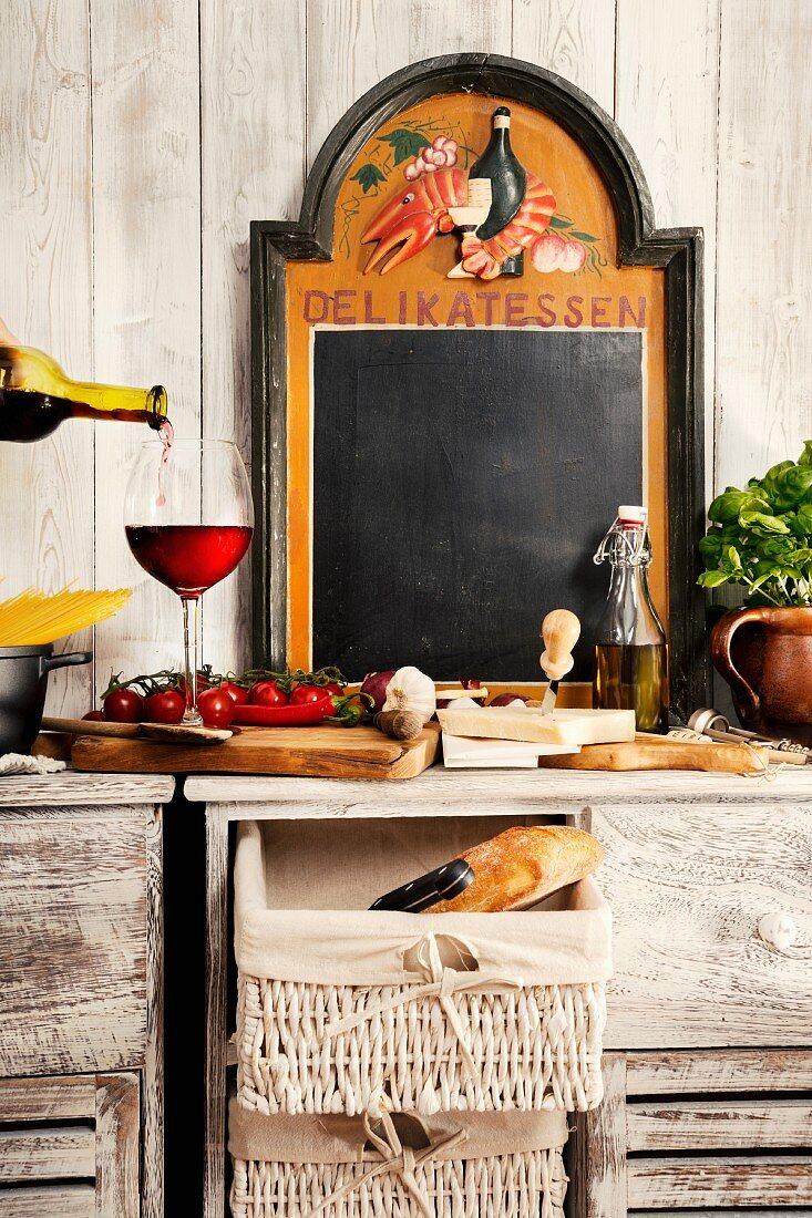 Still-life kitchen arrangement with typical Italian ingredients & chalkboard