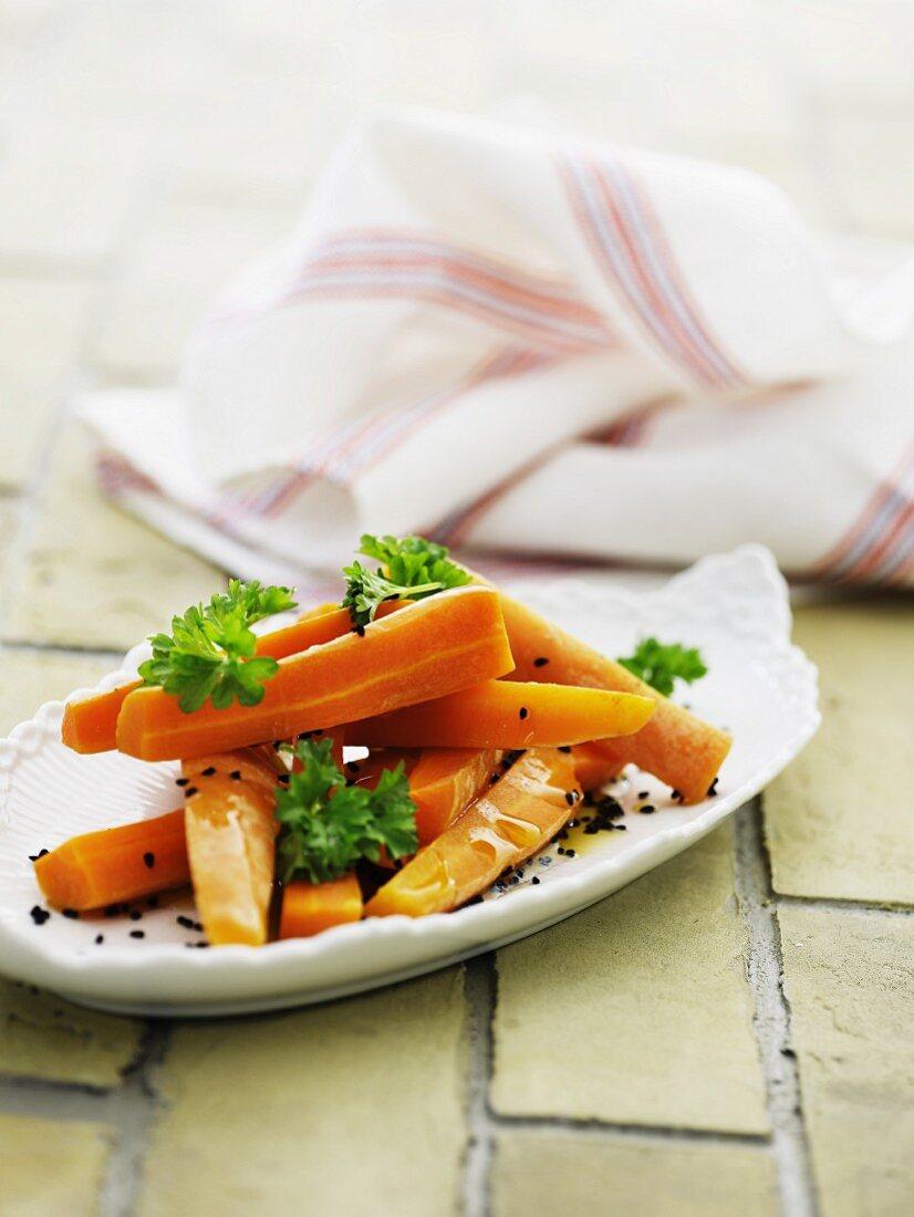 Carrots in orange sauce with black sesame seeds