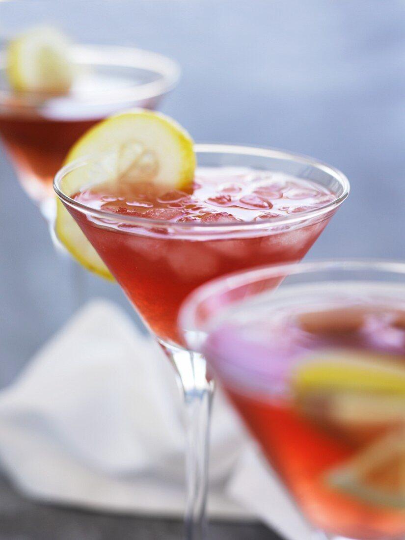 Cosmopolitans (cocktails made with vodka, orange liqueur, cranberry and lime juice)