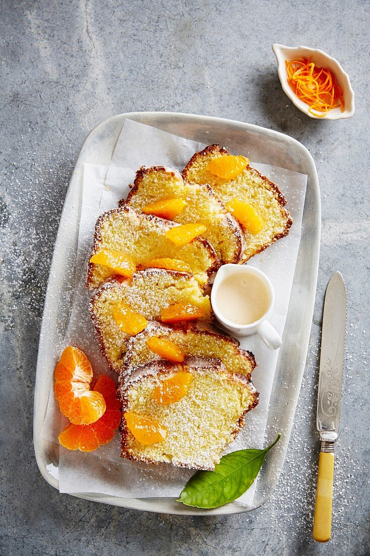 Madeira cake with clementines and sugar glaze