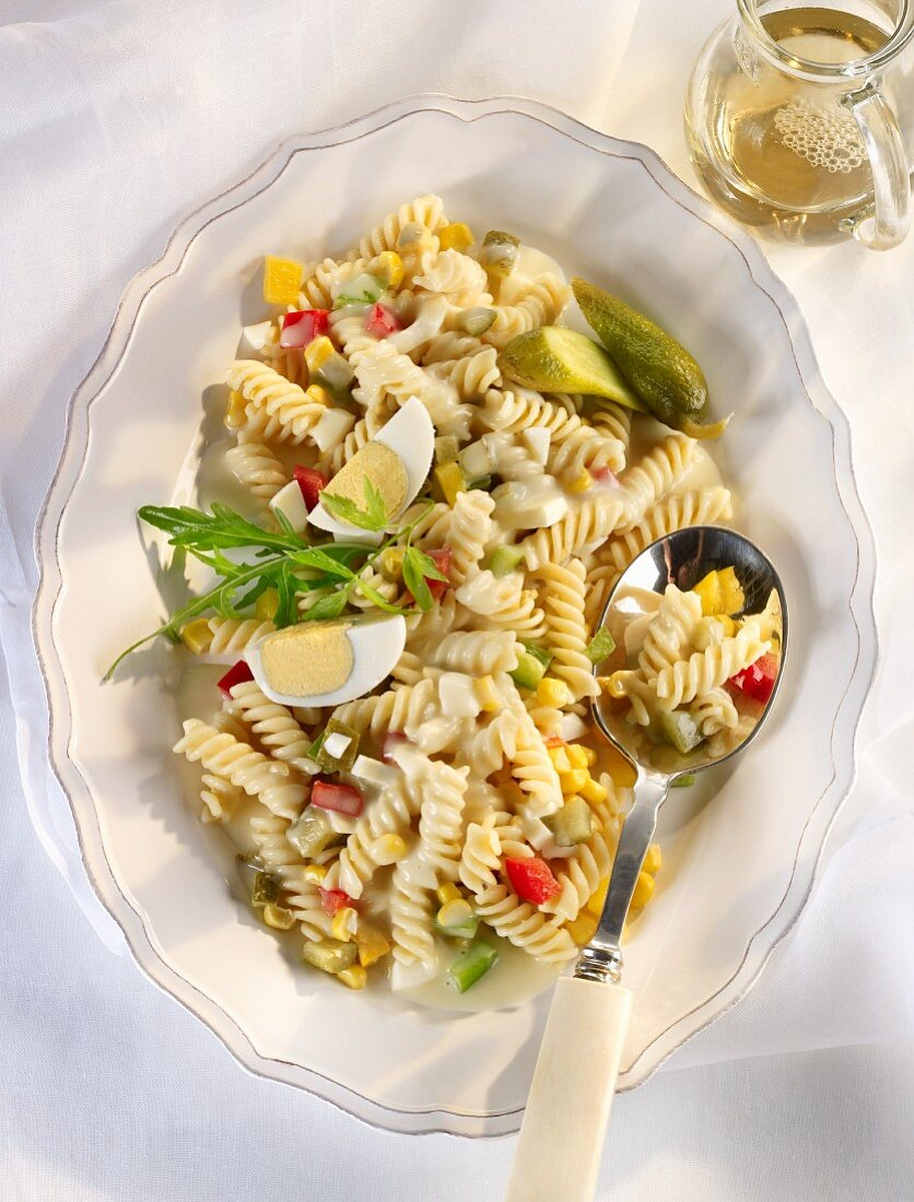 Pasta salad with hard-boiled eggs and diced vegetables