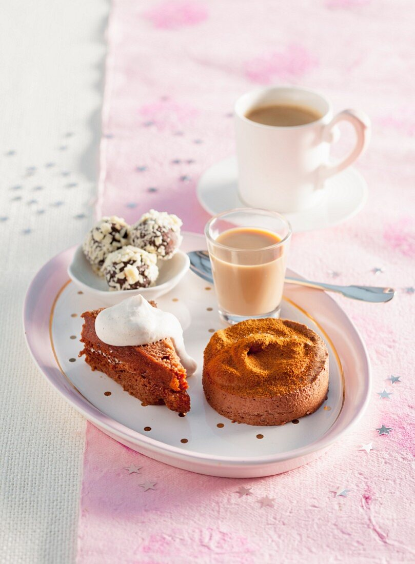 A Christmas dessert platter with chocolate parfait, chocolate cake, chocolate truffles and chocolate liqueur