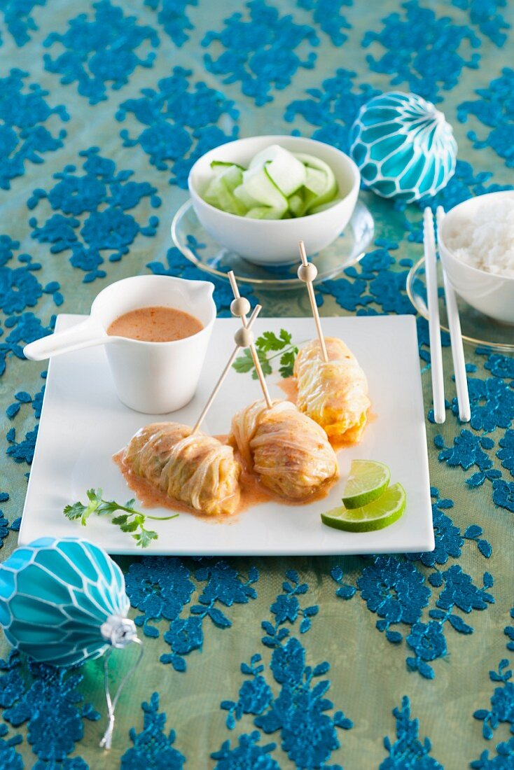 Chinese cabbage roulade with minced meat and coconut sauce for Christmas
