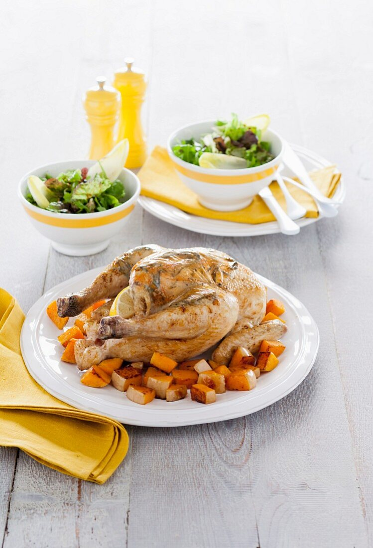 Garlic chicken with pumpkin and a side salad (Italy)
