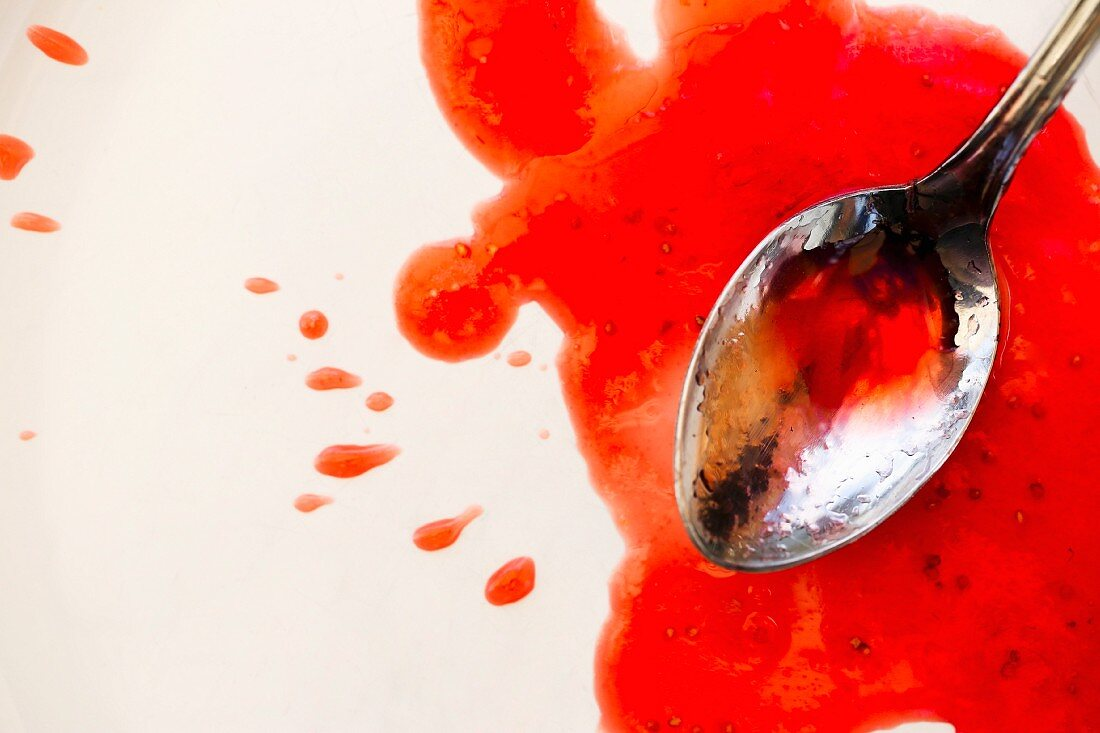Strawberry jam with a spoon (close-up)
