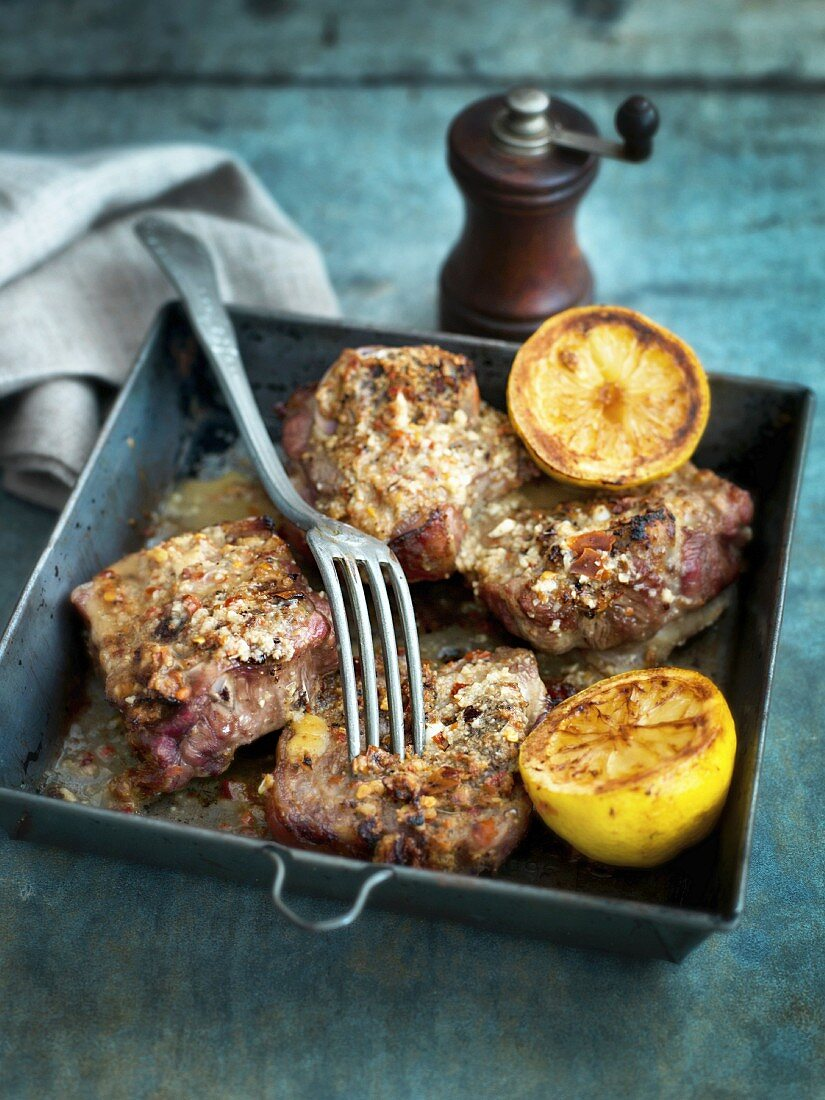 Oven-baked lamb with chilli and lemon