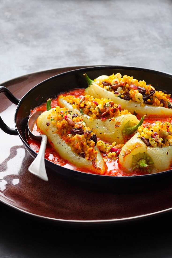 Stuff pointed peppers with raisins, feta cheese and mint