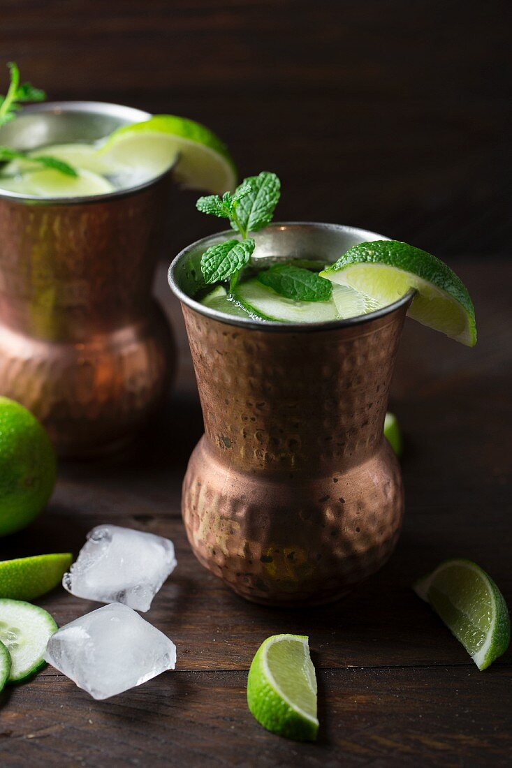 Cocktails made with ginger beer, vodka, limes, cucumber and mint